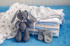 Baby clothes with diapers are stacked Stock Image