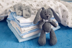 Baby clothes with diapers are stacked Royalty Free Stock Photos