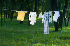 Baby Clothes dry on a rope outdoors Stock Image