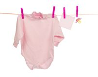 Baby clothes drying on the rope Stock Images