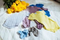 Baby clothes on fabric background. Copy space stock photos