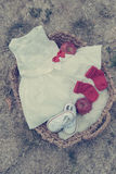 Baby clothes. For first birthday in wooden basket royalty free stock photos