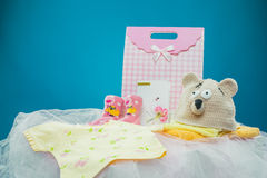 The baby clothes with a  gift box Stock Photography