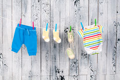 Baby clothes hanging on the clothesline. Royalty Free Stock Photo