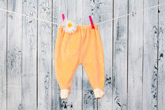 Baby clothes hanging on the clothesline. Stock Photos