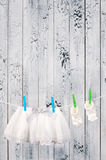 Baby clothes hanging on the clothesline. Royalty Free Stock Photos