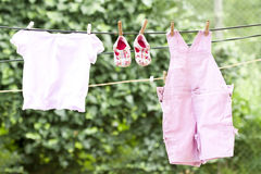 Baby clothes hanging Royalty Free Stock Photography
