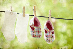 Baby clothes hanging Stock Image