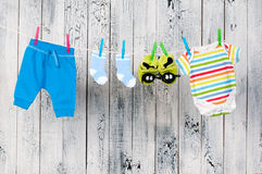 Baby clothes hanging on the clothesline. Stock Photo