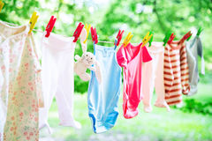 Baby clothes hanging on the clothesline. Royalty Free Stock Images