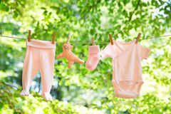 Baby clothes hanging on the clothesline. Royalty Free Stock Image