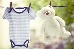 Baby clothes hanging on the clothesline Stock Photography