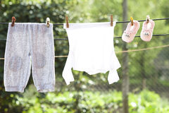 Baby clothes hanging on the clothesline Royalty Free Stock Images
