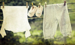 Baby clothes hanging on the clothesline Stock Photo