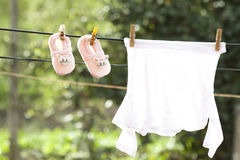 Baby clothes hanging on the clothesline Royalty Free Stock Photos