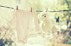 Baby clothes hanging on the clothesline Royalty Free Stock Photo