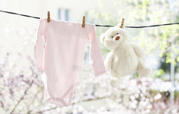 Baby clothes hanging on the clothesline Royalty Free Stock Image