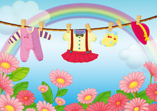 Baby clothes hanging in the garden. Illustration of the baby clothes hanging in the garden Stock Photos