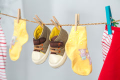 Baby clothes. Hanging on the rack on white background stock photography
