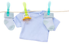 Baby clothes hanging on rope Royalty Free Stock Images