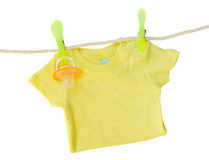 Baby clothes hanging on rope Stock Photo