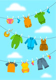 Baby clothes hanging on ropes with clothespins. Vector flat vertical background. Newborn kid welcome banner. Baby shower party cartoon card. Garments for Stock Photography