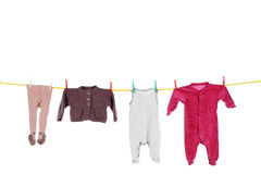 Baby clothes hanging on washing line Stock Photography