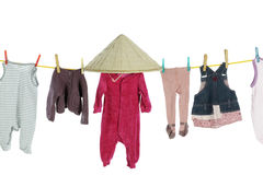 Baby clothes hanging on washing line Stock Images