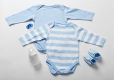 Baby clothes and necessities. On light background stock photography