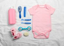 Baby clothes and necessities. On white towel background royalty free stock photos