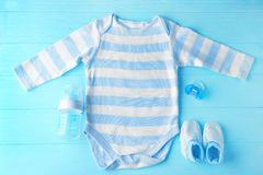 Baby clothes and necessities. On wooden background royalty free stock images