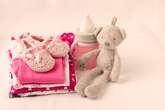Baby clothes for newborn. In pink colors for girls. Tone pink. shallow DOF stock photos