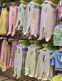 Baby clothes for newborns in the store Royalty Free Stock Images