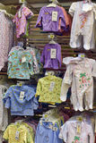 Baby clothes for newborns in the store Royalty Free Stock Photos