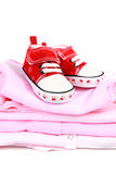 Baby Clothes and red shoes Stock Photography