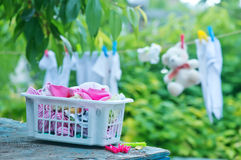 Baby clothes. On rope in the garden stock photo