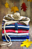 Baby clothes. Baby clothes on a rustic wooden background royalty free stock images