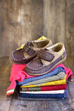 Baby clothes . Baby clothes on a rustic wooden background royalty free stock photo