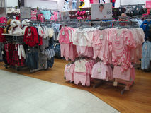 Baby clothes for sale in a store. royalty free stock photo