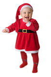 Baby in the clothes of Santa Claus. Stock Photo