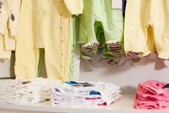 Baby clothes shop. Shelf with baby clothes in a boutique Stock Photography