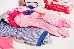 Baby clothes shop. Shelf with baby clothes in a boutique Stock Image