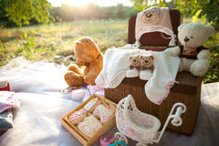 Baby clothes and soft toys Stock Photos