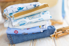 Baby clothes. A stack of baby clothes stock photography