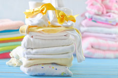 Baby clothes. On a table royalty free stock images