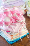 Baby clothes. On a table stock image