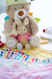 Baby clothes and toys Stock Image