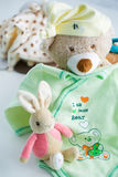 Baby clothes and toys Stock Photography