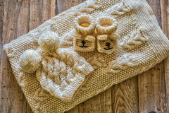 Baby clothes. On a vintage wooden table stock images