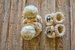 Baby clothes. On a vintage wooden table royalty free stock photo